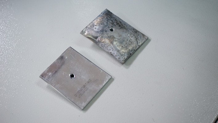 Catastrophic testing of an original CM battery and a fake one. Guess which one burst into flames?
