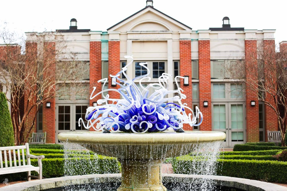 The classic chihuly piece that sits atop the fountain, central to the garden.