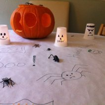 Use a black sharpie or felt pen to draw spooky faces on plastic cups