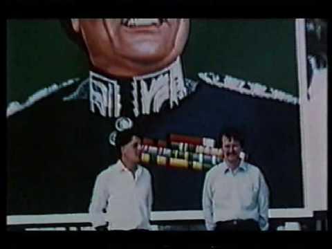 fascist loons Nick Griffin and Derek Holland pose under a Gaddafi portrait in Libya