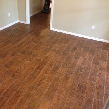 "This really is tile! A great ""hardwood floor"" look. We did over 3000 sq ft on a main floor this way! It looks great and is a fantastic alternative for homes with pets."