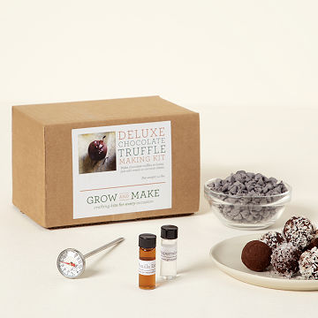 Truffles and Ingredients with Deluxe Chocolate Truffle Making Kit in Background