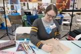 Artist Alexandra Brodt draws Batgirl at Geekinomicon - photo by Dennis Spielman