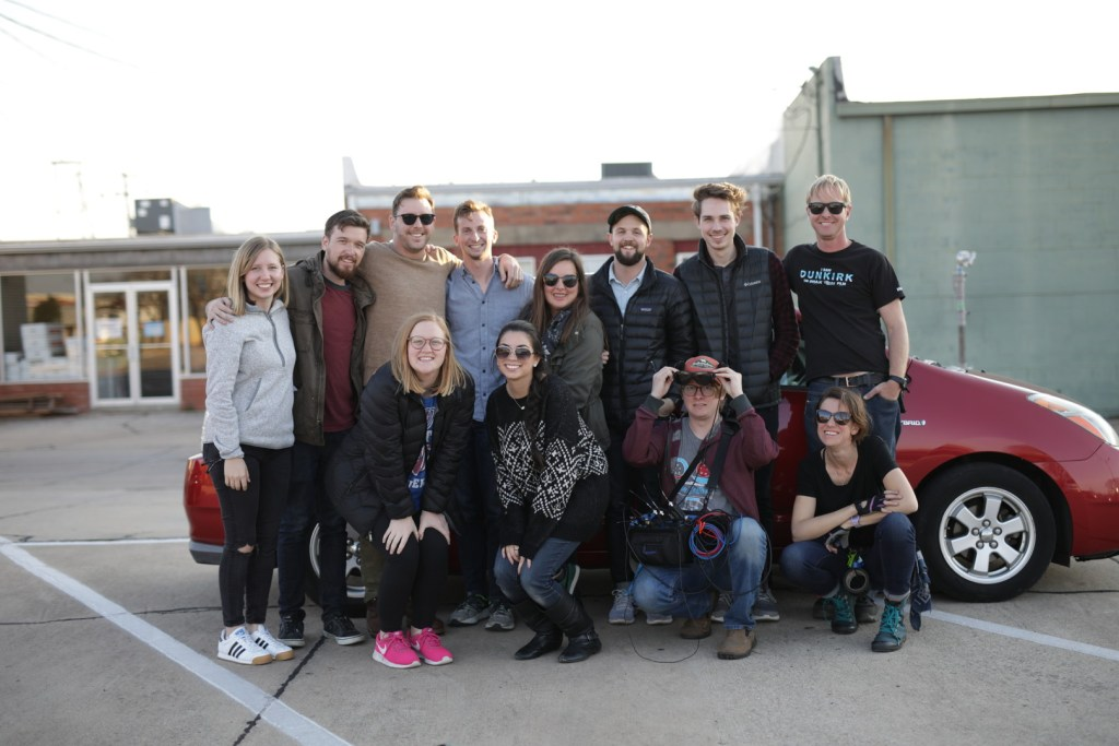 The crew poses for a picture after wrapping the film