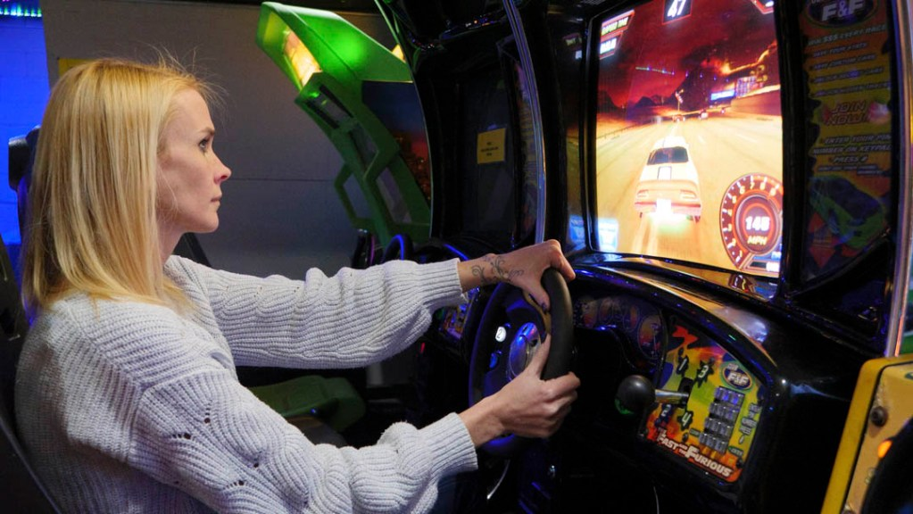 Laura Daigle plays a racing game at Level Up Arcade - photo by Dennis Spielman