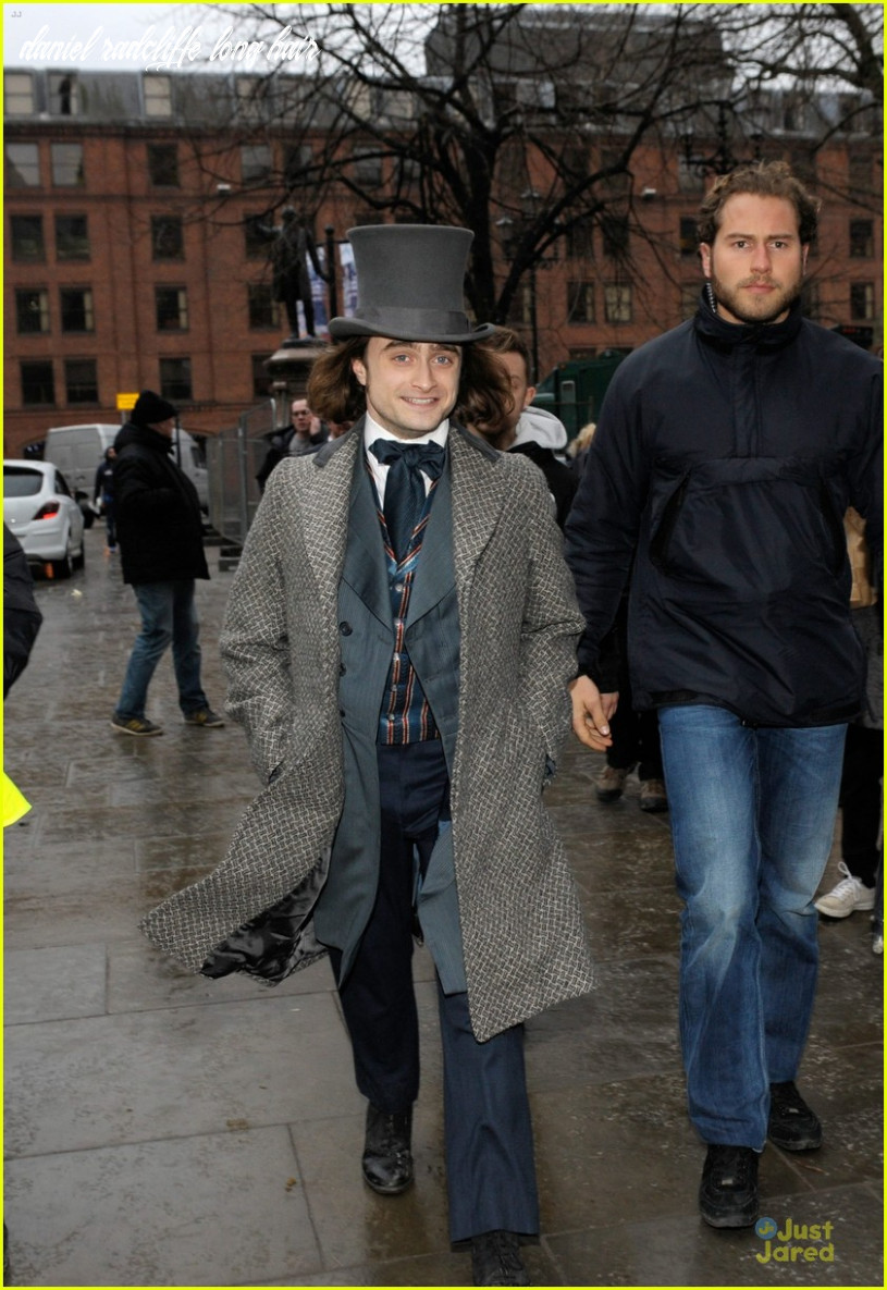 Daniel radcliffe covers long hair with topper hat for
