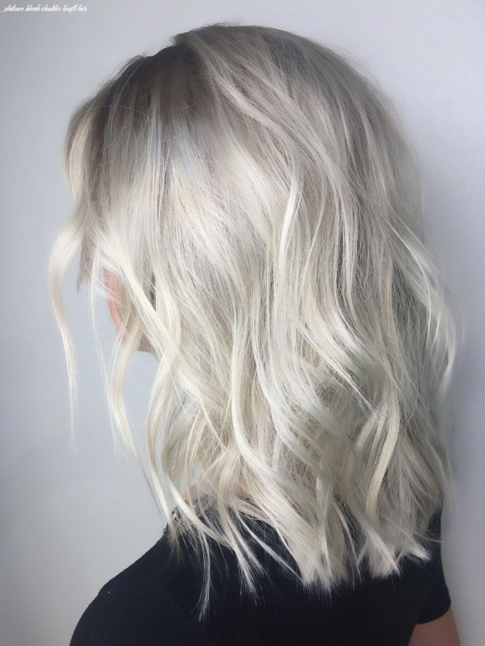 Medium length , platinum ice blonde with shadowed roots and lived