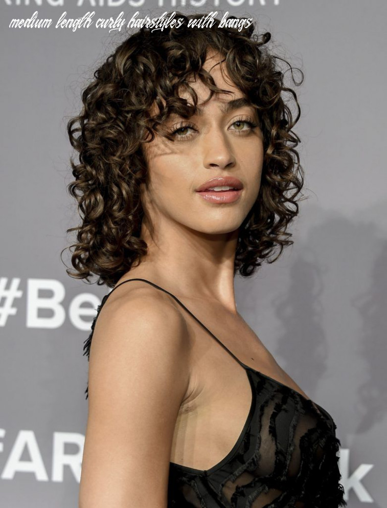 See how to style curly hair and bangs the a list way medium length curly hairstyles with bangs