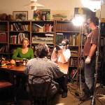 Waylon Bacon films a scene around a dinner table