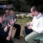 Filmmaker Usama Alshaibi films an interview with an Iraqi man