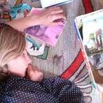 Lilie Bytheway-Hoy has fallen asleep on her artwork