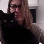 Filmmaker and dancer Élisabeth Desbiens attempts to write her next script with some help black kitty Petit-Poux.