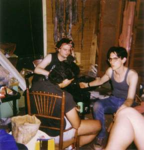Bunch of guys sitting around on a messy, crowded film set interior