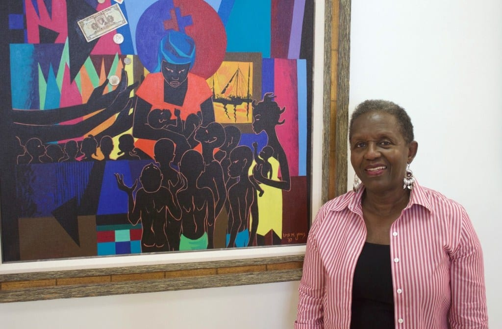 """Gallery owner Stella Jones with """"Haiti Demain,"""" 1987 (mixed-media collage on canvas) by Lois Mailou Jones. 