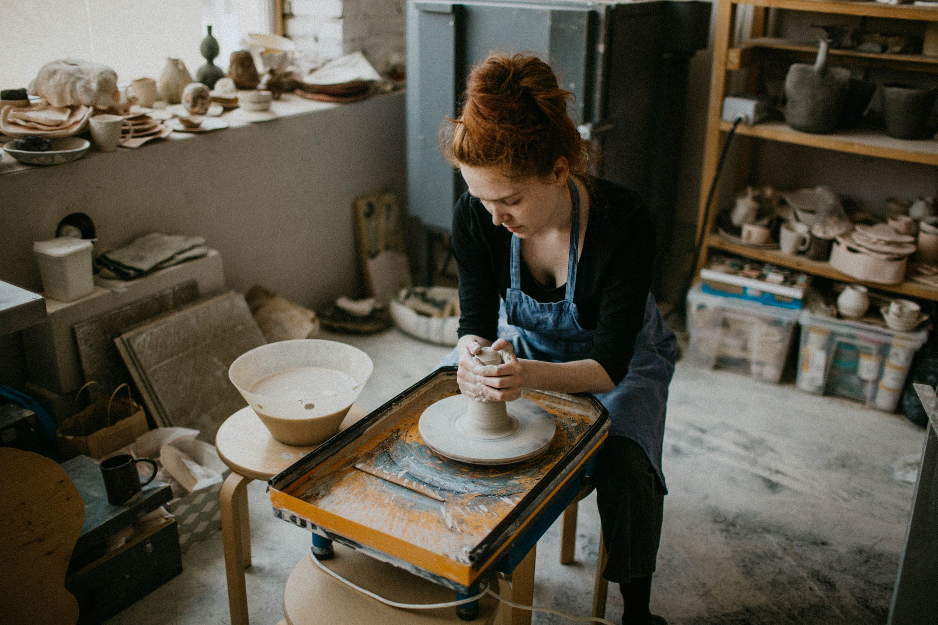 woman holding clay