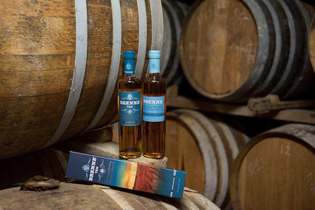Bottles of Brenne Whisky stand atop barrels | © Sarah Baumberger/Brenne Whisky