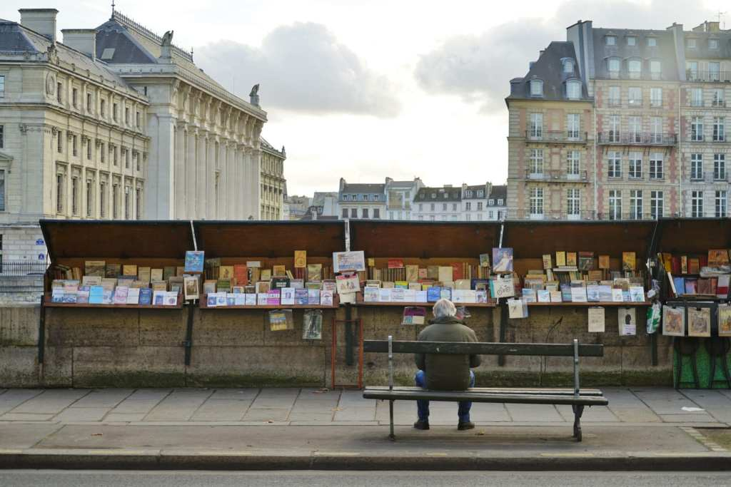 A Bouquiniste booth by the Seine river in Paris   © EQRoy/Shutterstock