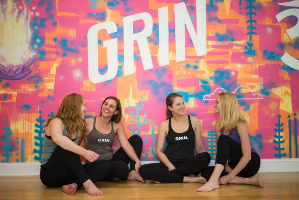 Grinning Yogi is a woman-owned yoga studio in Seattle © | Courtesy of Grinning Yogi's Facebook Page