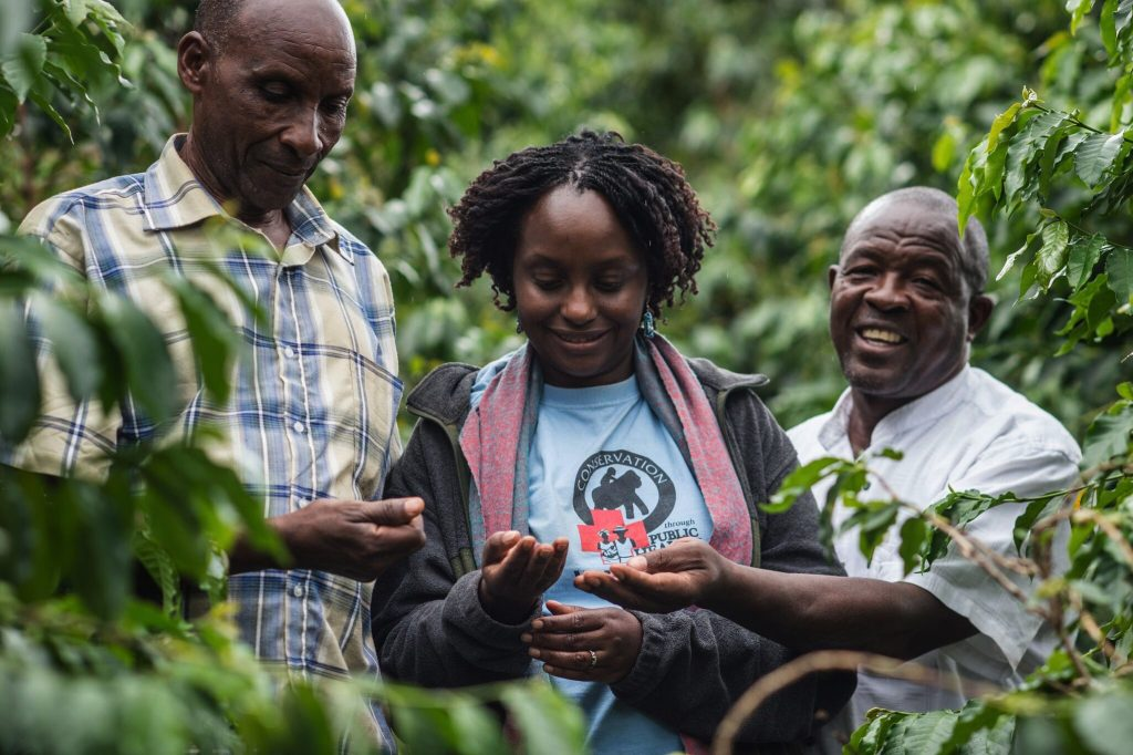 Dr. Gladys with Gorilla Conservation Coffee lead farmers, Vincent and Sam Karibwende © | JMcArthur/Unbound Project