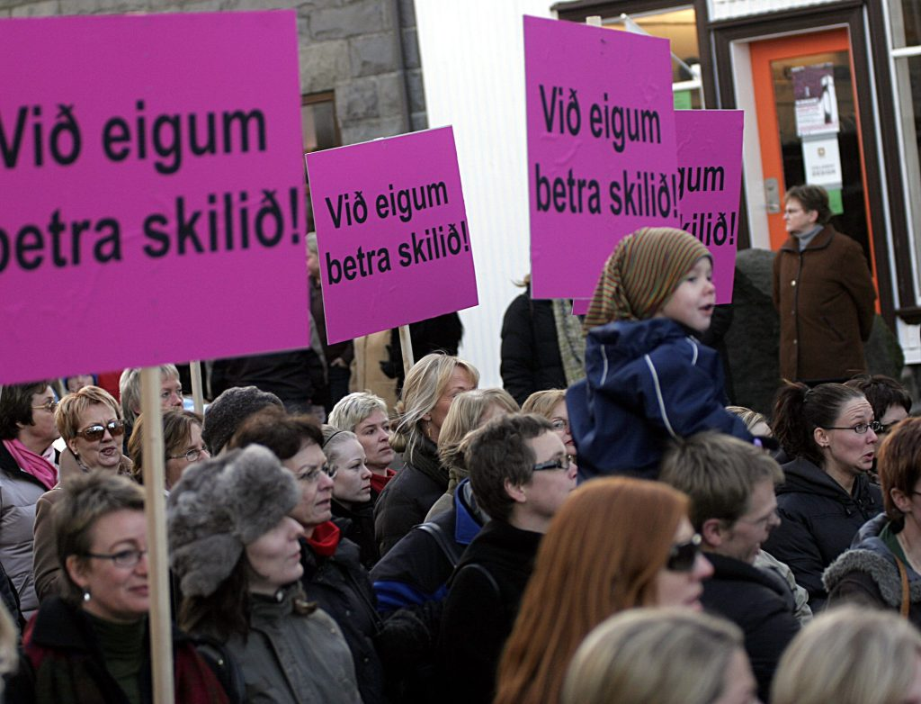 Although Iceland leads the way for gender equality, women are still pushing for equality. Here Icelandic women protest in the streets for equal rights.  | © Petur Asgeirsson/Shutterstock