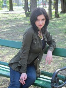 Young woman resting elbow on a bench