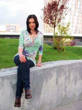 Young woman sitting legs crossed