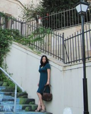 Colored stairs woman in green