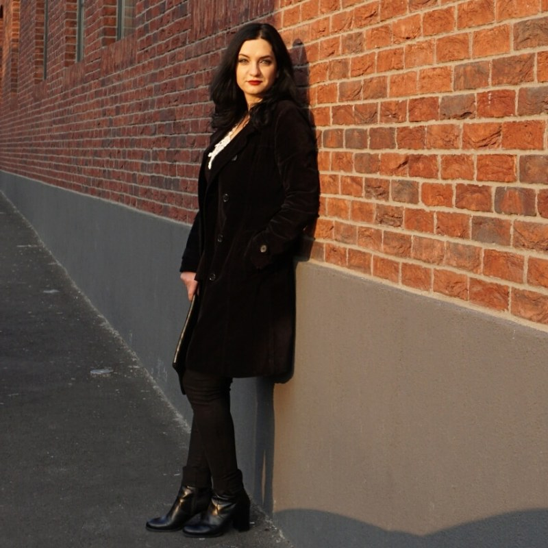Woman wearing velvet trench coat