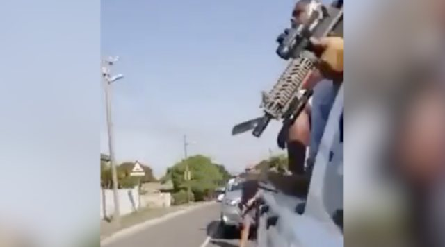 WATCH: Intense Video Shows Armed Vigilantes Driving Around And Shooting At Looters In South Africa!