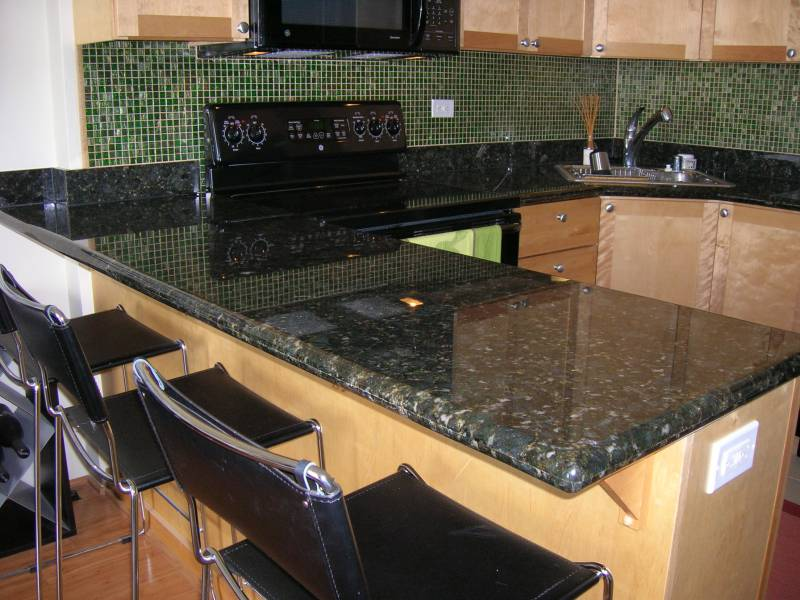The Pros And Cons Of Black Granite Countertops | A ... on Black Granite Countertops  id=61652