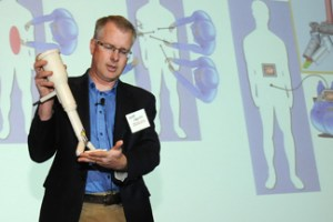Shane Farritor, an engineer at UNL and co-founder of Virtual Incision, displays his new surgical device during UNeMed Corporation's inaugural UNMC Startup Company Demonstration Day.