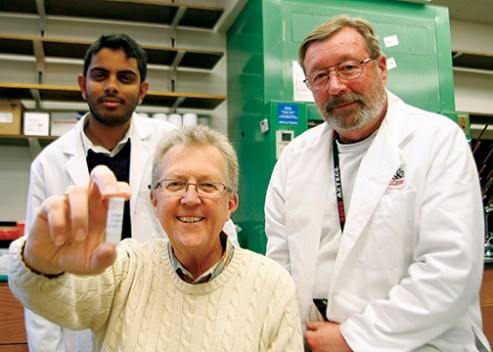 ProTransit Nanotherapy president and CEO Gary Madsen, Ph.D., (center) shows off a vial of prototypes that could one day be incorporated into skin care products such as sunscreen and cosmetics. The nanoparticles, formulated by scientists Steve Curran and Bala Vamsi Karuturi, Ph.D.,(left) and Steve Curran (right), are vehicles that can deliver powerful antioxidants to the deepest layers of skin where they can help prevent skin cancer, wrinkles and blemishes.