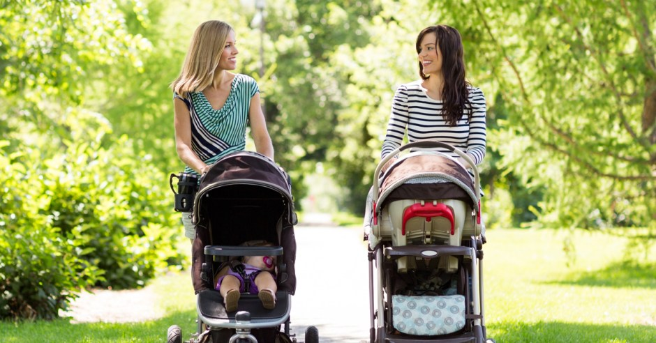 Mothers With Baby Carriages Walking In Park