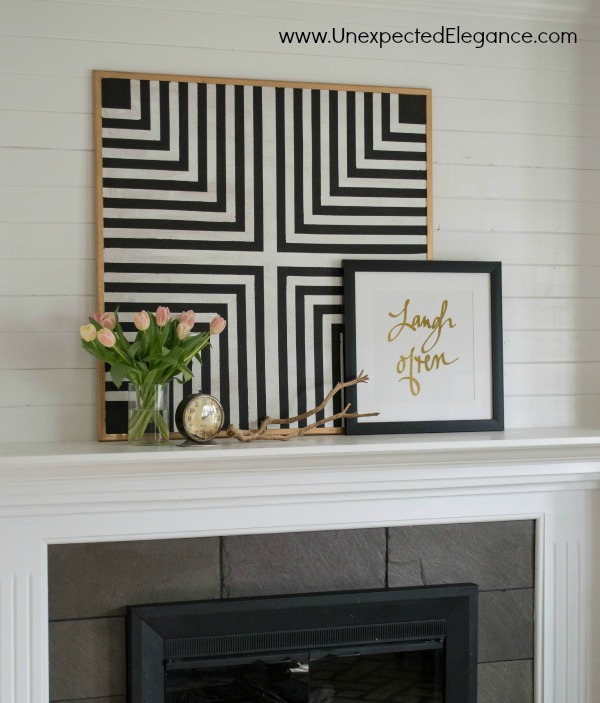 Black and White Bulletin Board-1-10Need some inexpensive artwork that can function as a bulletin board?  Get a full tutorial for making your own DIY geometric artwork!