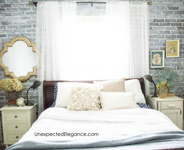 Check out this loft-inspired makeover! A few economical changes to a guest bedroom completely changed the feel.