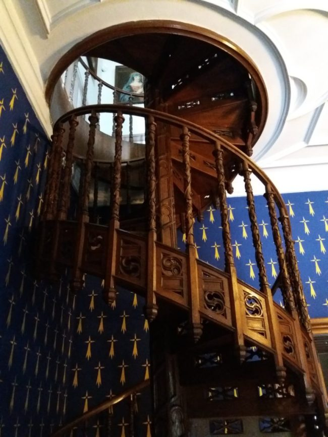 A photo of a wooden staircase - Sychrov, Czechia