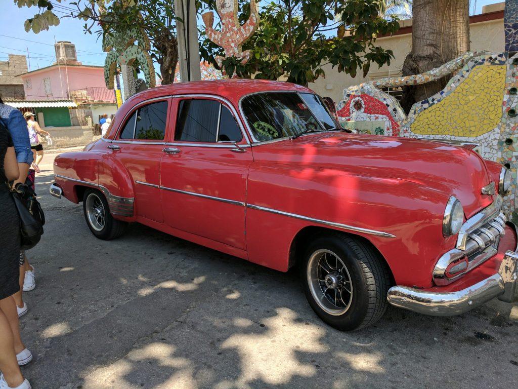 Red Taxi in Havana, Cuba on UnfoldAndBegin.com