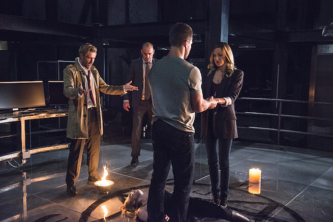 """Arrow -- """"Haunted"""" -- Image AR404B_0027b.jpg -- Pictured (L-R) Matt Ryan as Constantine, Paul Blackthorne as Detective Quentin Lance, Stephen Amell as Oliver Queen and Katie Cassidy as Laurel Lance -- Photo: Cate Cameron/ The CW -- © 2015 The CW Network, LLC. All Rights Reserved."""
