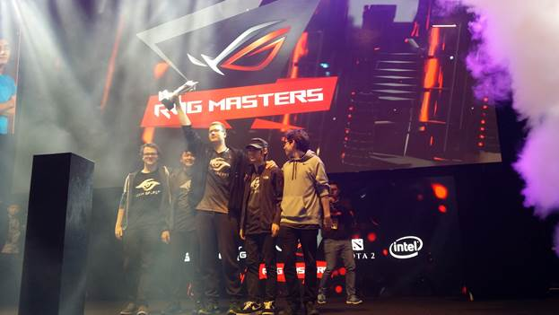 Puppey holds the ROG Masters trophy up high as they take the grand finals with a vengeance!