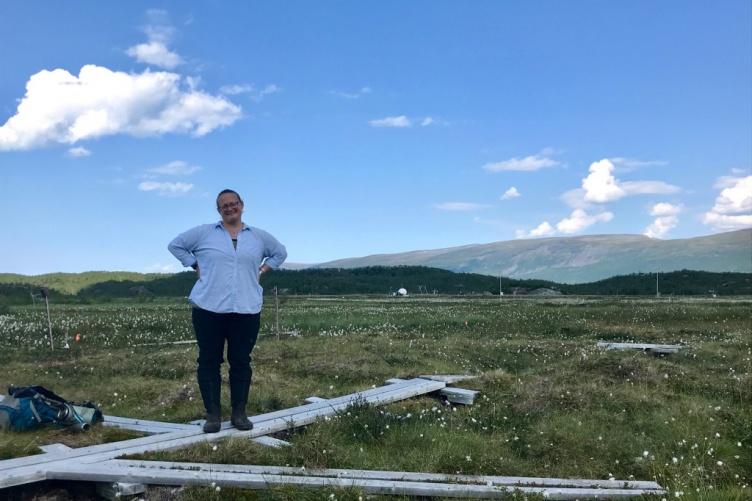 Ruth Varner stands on a boardwalk in Abisko, Sweden.