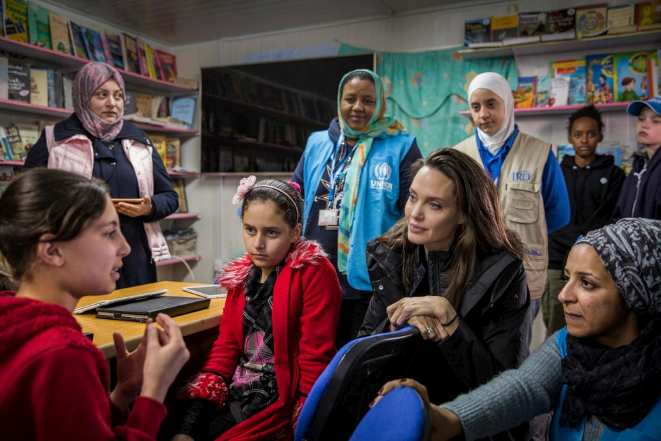 UNHCR Special Envoy Angelina Jolie talks to Syrian children at Za'atari camp in Jordan.