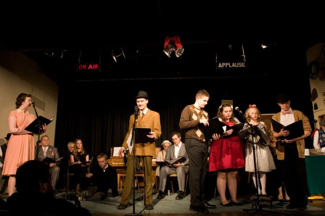 "Voice actors portray ""It's A Wonderful Life"" on stage at the Fire Hall Theatre."
