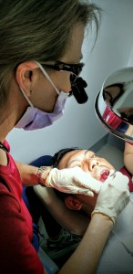 Dr. Kordie Reinhold works on a 28-year-old man who had 12 teeth pulled.