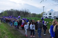 Some of the thousands of Prince fans who showed up at Paisley Park on Sunday despite the inclement weather.