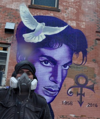 Twin Cities mural and graffiti artist Rock Cyfi Martinez painted his Prince mural in Uptown on Saturday in about seven hours. He said it was a gift to the city of Minneapolis.