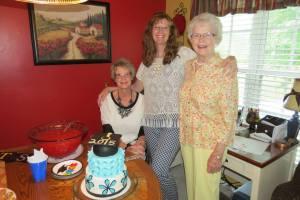Becky Leguee Siani (center), Eileen Leguee Warzeka and Ardie Leguee.