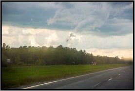 August 18: A change in the weather, photographed through the windshield in central Minnesota the other day.