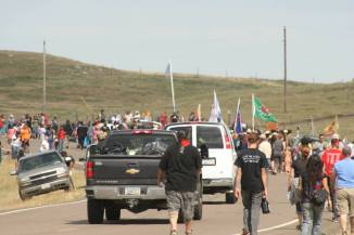 Activists directed traffic. Others brought water to marchers on the two-mile trek uphill in 90-degree weather.