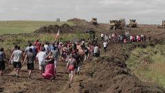 Protesters pushed bulldozers off what they believed to be a sacred burial ground. Papers attesting to the importance of the site were filed in federal court on Friday. On Saturday, bulldozers were moved some 12 miles from a worksite here, where they leveled the ground.