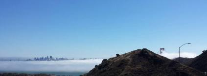Foggy Golden Gate with San Francisco in the background.